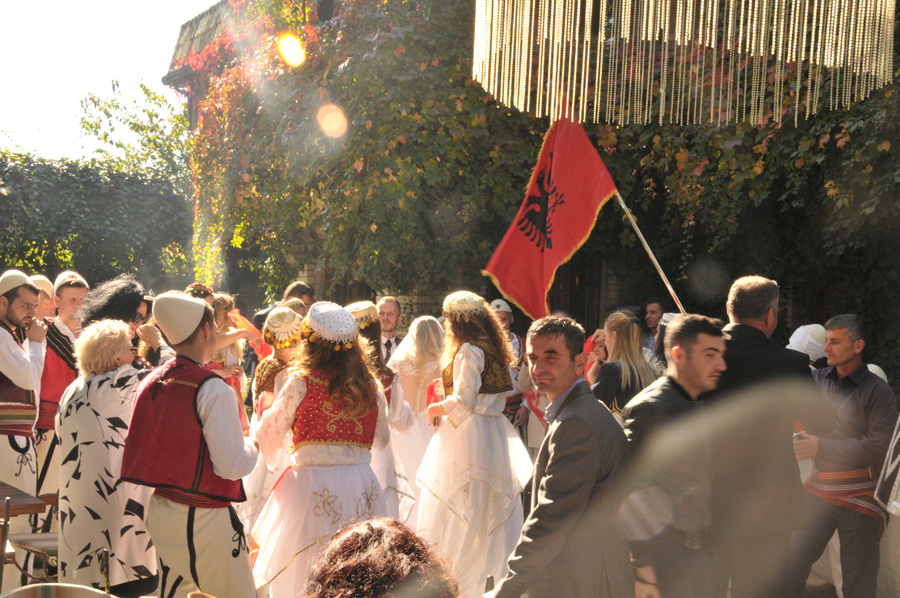 albanian wedding outside with flag