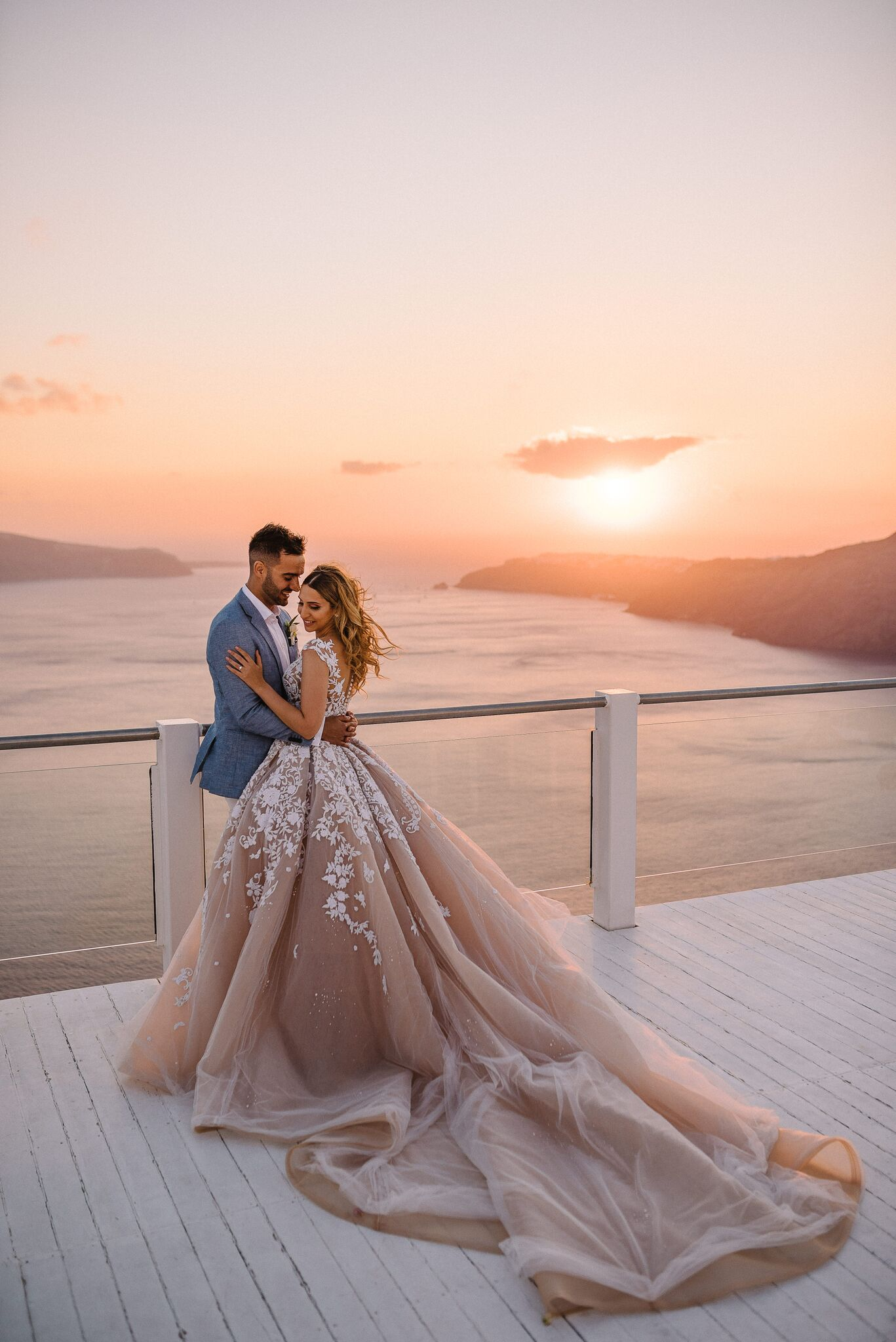 An All White Wedding Set Against The Santorini Sunset